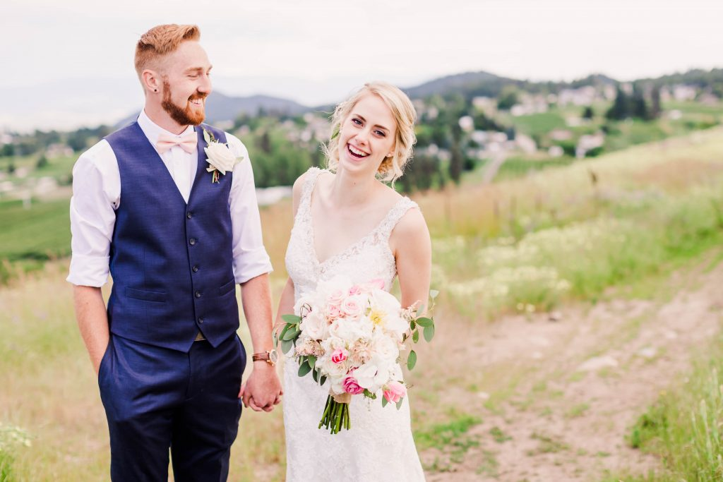 bride and groom photo smiling in kelowna and in grande prairie. very happy couple in love.