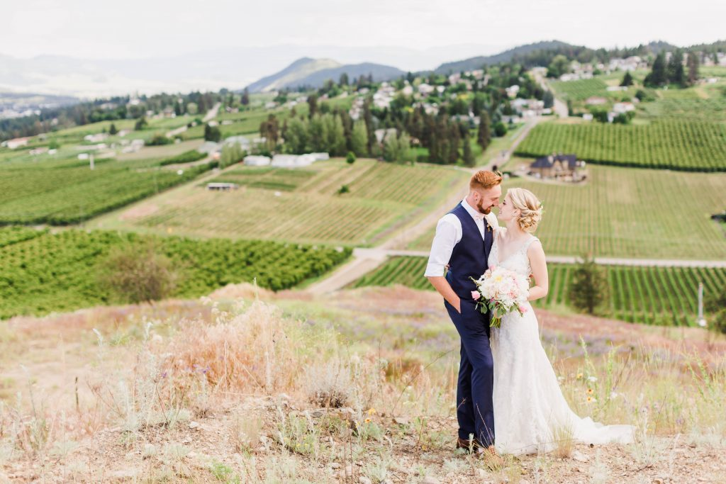 beautiful wedding couple in the okanagan grande prairie mountains and vinyards