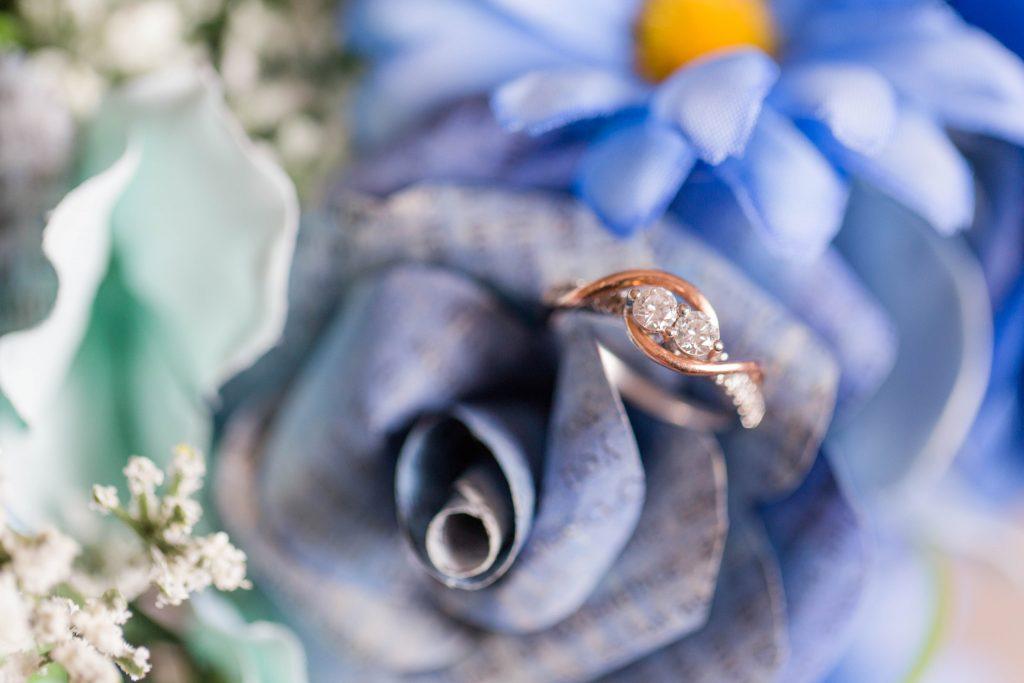 bride's wedding ring in the beautiful blue and purple wedding bouquet flowers
