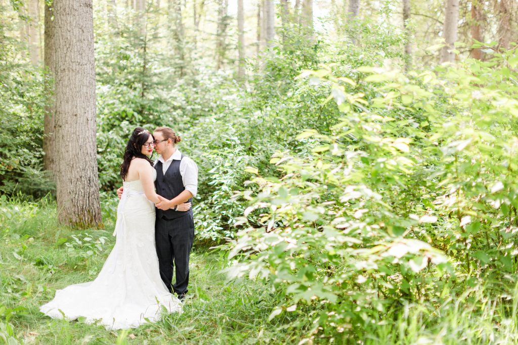 grande prairie wedding couple holding hands in the forest photography