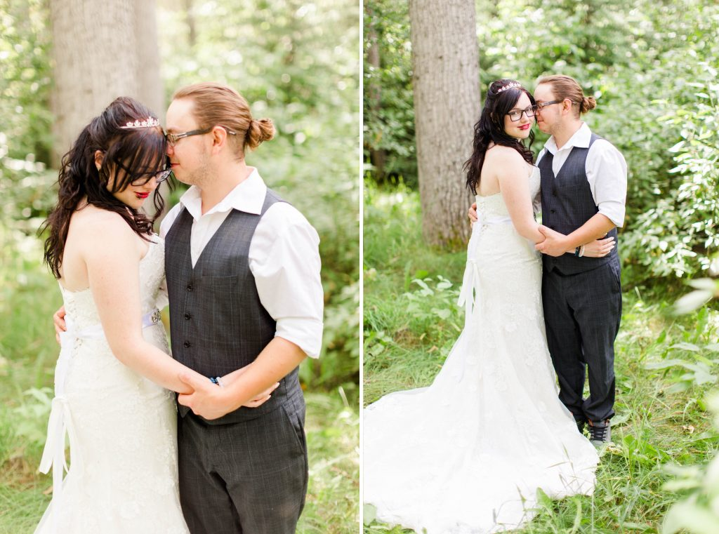 grande prairie wedding photographer couple nuzzle and holding hands in forest