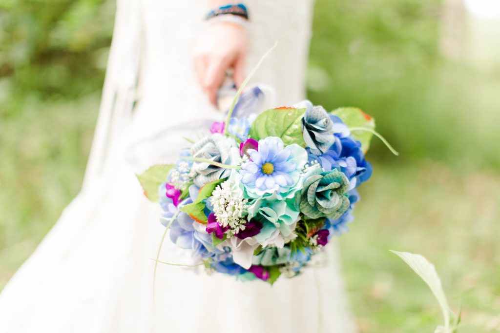 close up photo of bride's blue and purple wedding bouquet