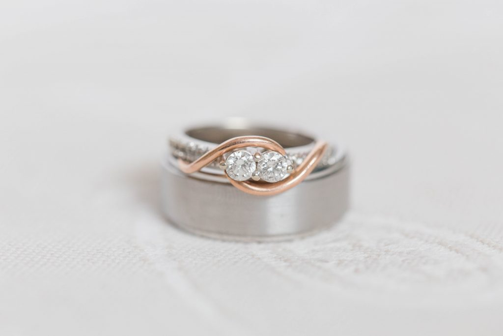 beautiful light and airy ring shot of bride and groom ring