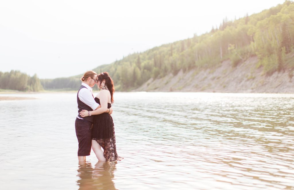 couple in the river as the sun goes down