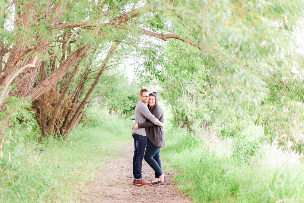 couple looking at the camera with kayla lynn photography in grande prairie