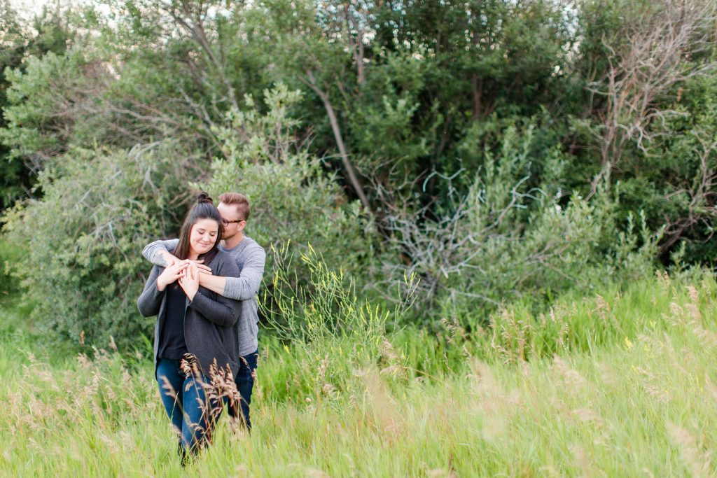 colby and robyn in a field near some trees