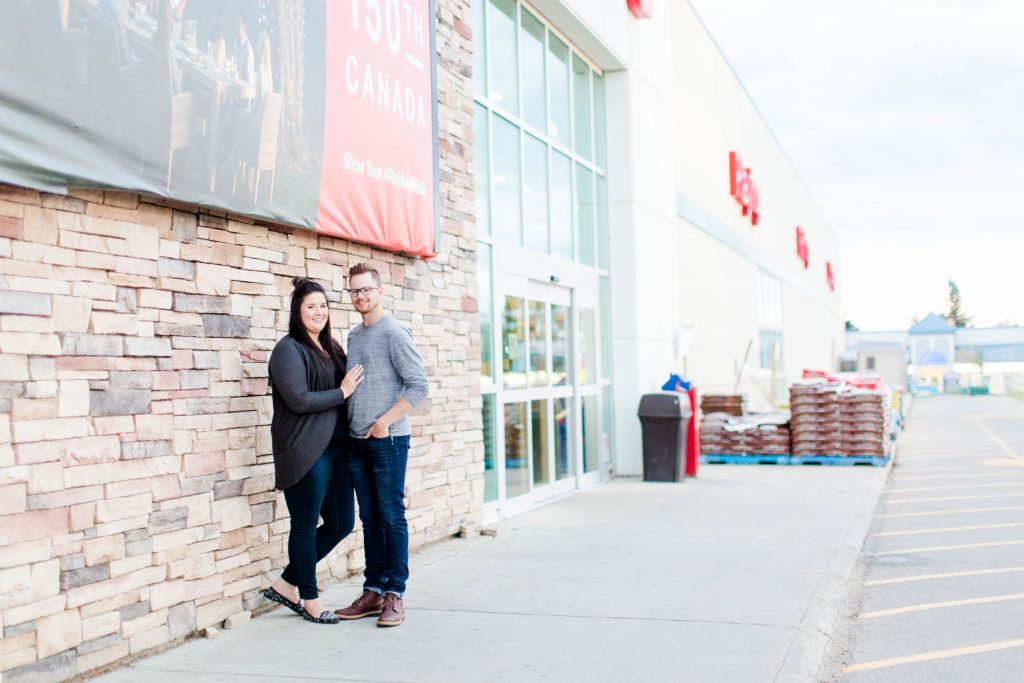 engagement couple standing near canadian tire in grande prairie
