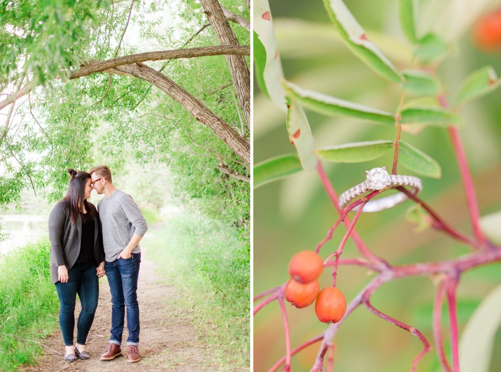 beautiful ring shot of engagement ring sitting on tree branches. Couple is forehead touching too