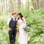 Grande Prairie wedding couple forehead in the trees photo