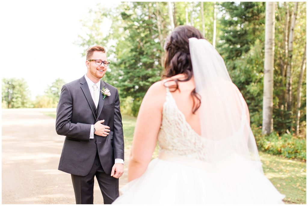 groom seeing his bride for the first time on the wedding day in tears beautiful