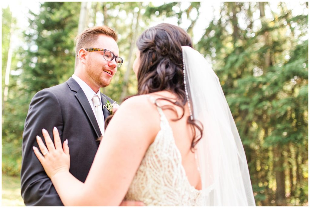 groom seeing his bride for the first time during first look outfit same proposed spot