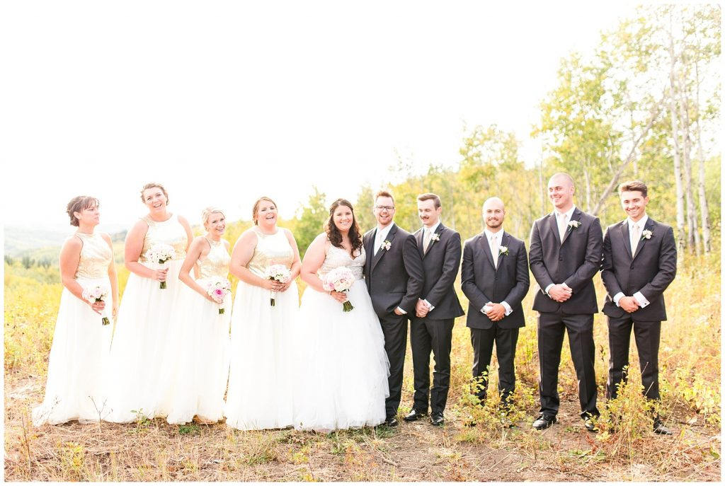 bride and groom with their wedding party with bridesmaids and groomsmen in September fall wedding