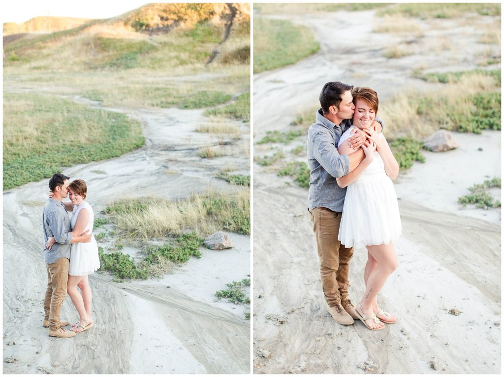 couple chest to chest at kleskun hills grande prairie cuddling it looks like a desert with kayla lynn photography
