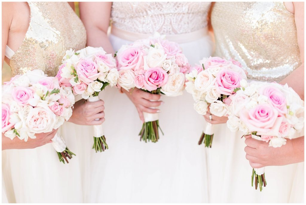 brides and bridesmaids pink blush flower by flowers by Charlene in Alberta