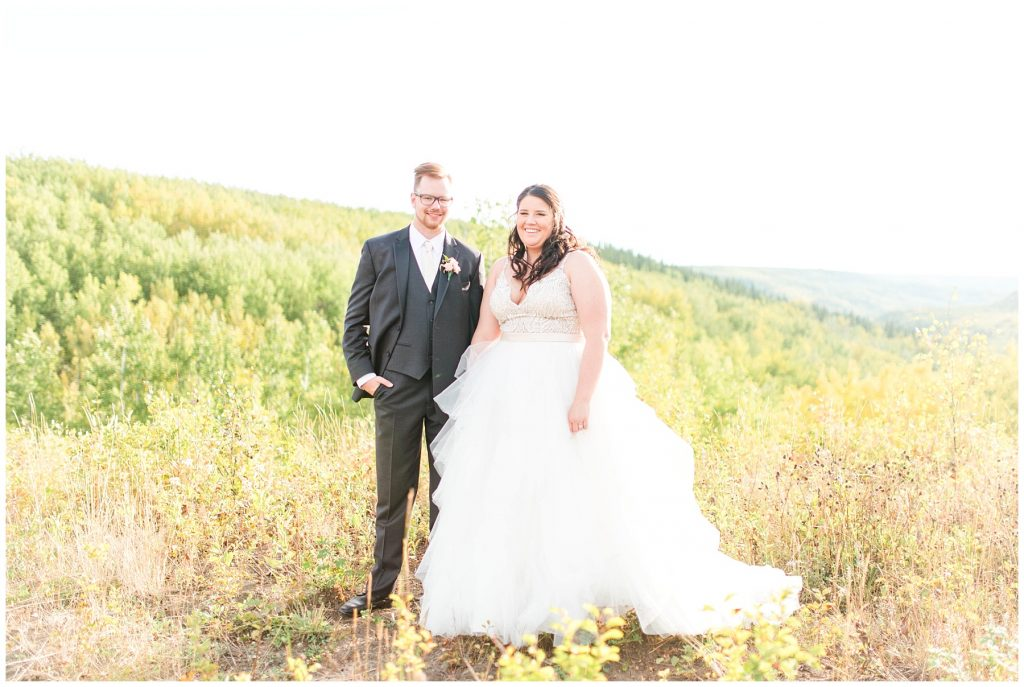 bride and groom smiling in the fall wedding