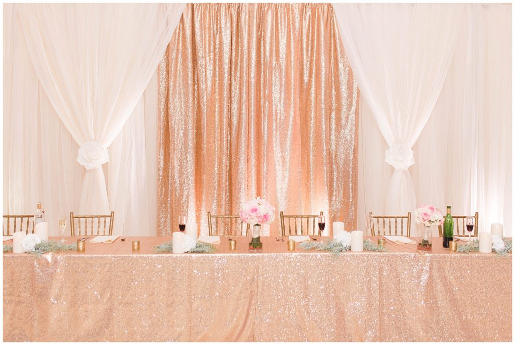 beautiful reception wedding table with lots of sparkles and gold