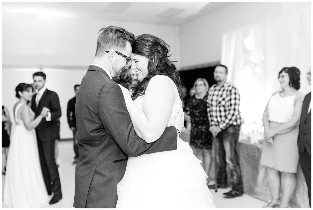 happy bride and groom robyn colby during their first dance