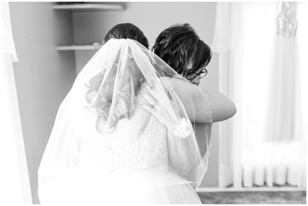 bride and mom hugging each other during brides getting ready emotional