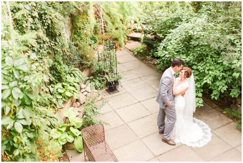 wedding couple at the millwood with kayla lynn photography very elegant organic and romantic
