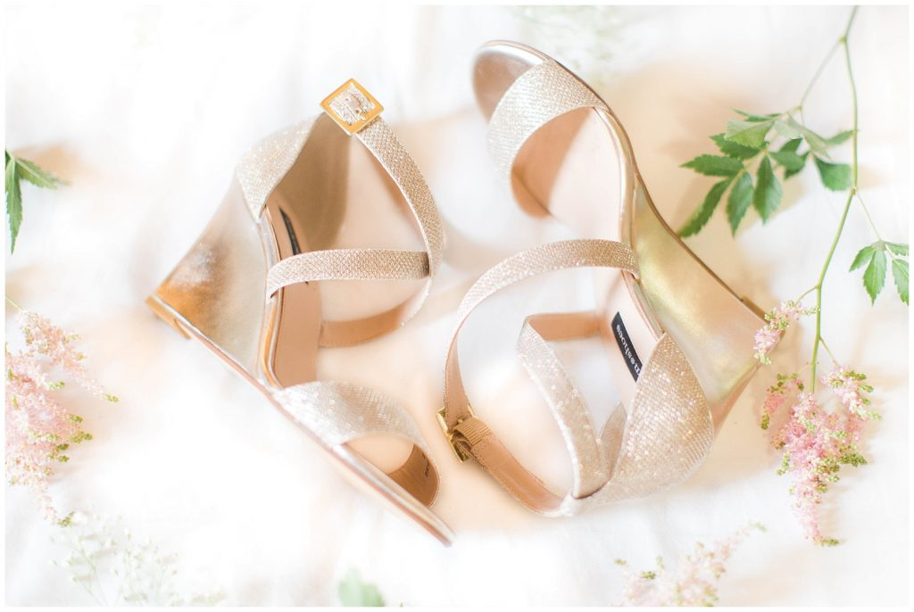 jessica bride golden wedding shoes very elegant surrounded by pretty pink flowers
