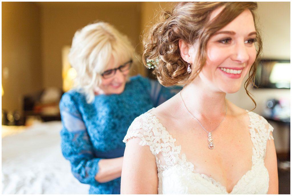 Jessica brides mom doing the wedding dress