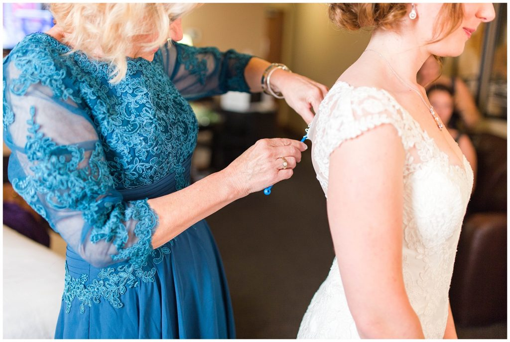 jessica mom wearing blue lace in the wedding ready room doing bride wedding dress