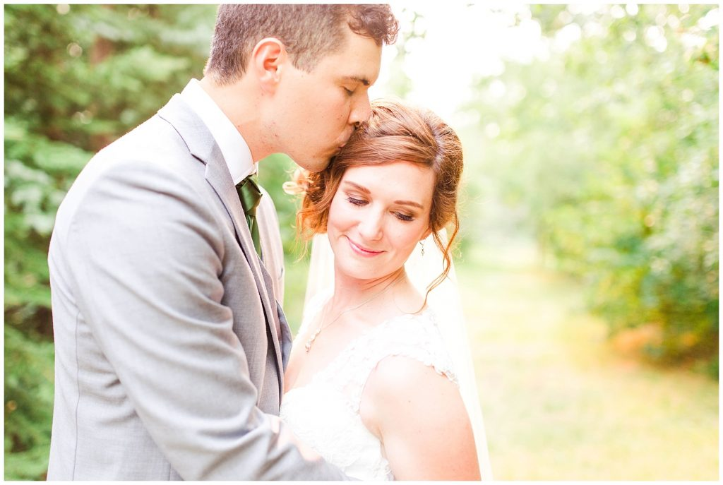 wedding couple in grande prairie at the millwood dreamy colorful airy wedding photo romantic