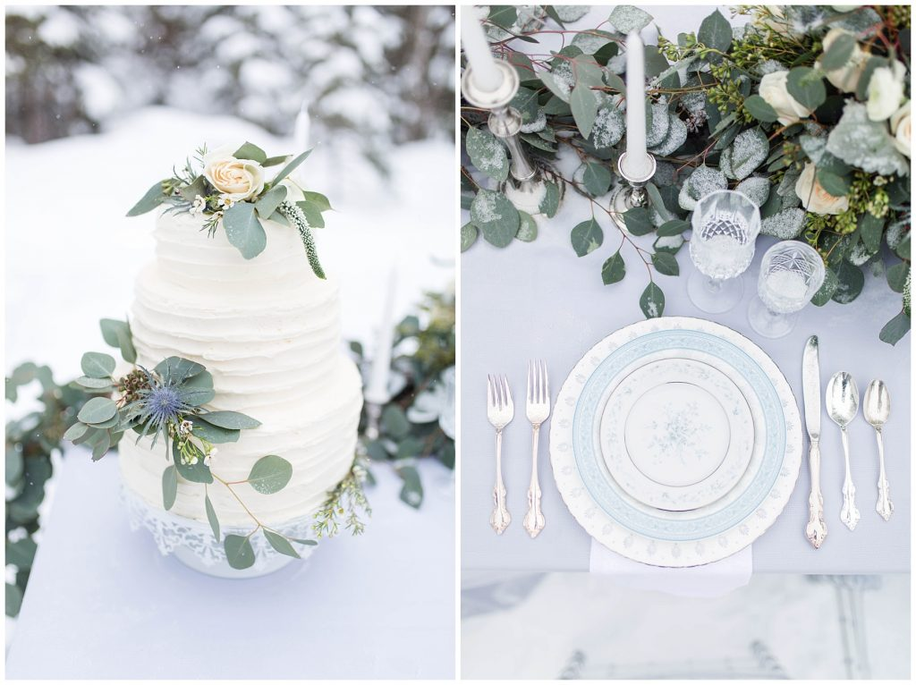 wedding cake and plates by changing dreams to reality in grande prairie on a light and airy blue table cloth with silver and clear cups and greenery