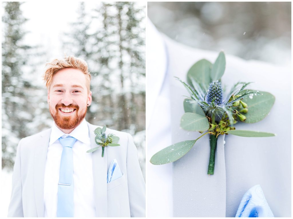 happy groom with his blue thistle silver dollar boutonniere in the winter wedding styled shoot