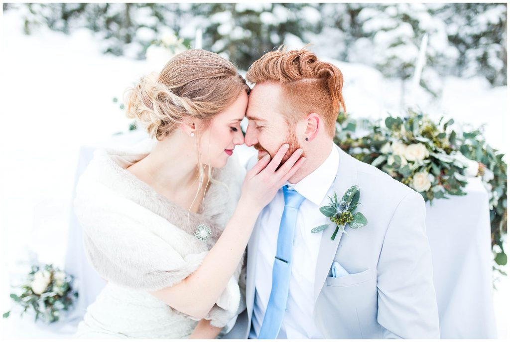 grande prairie wedding photographer in a winter wedding styled shoot with bride and groom janaya and mark nose to nose so romantic and so much winter
