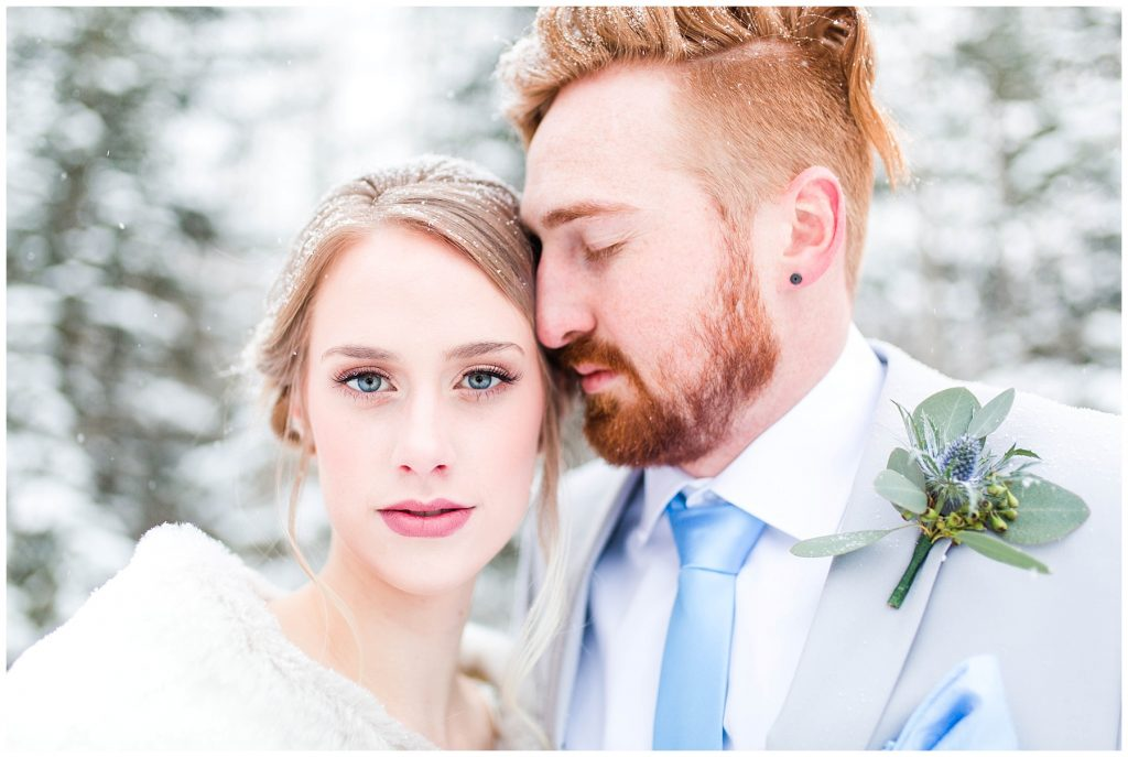 beautiful bride with makeup done by makeup by lina and salon west hair design by brittany outdoor for their winter wedding photography in grande prairie