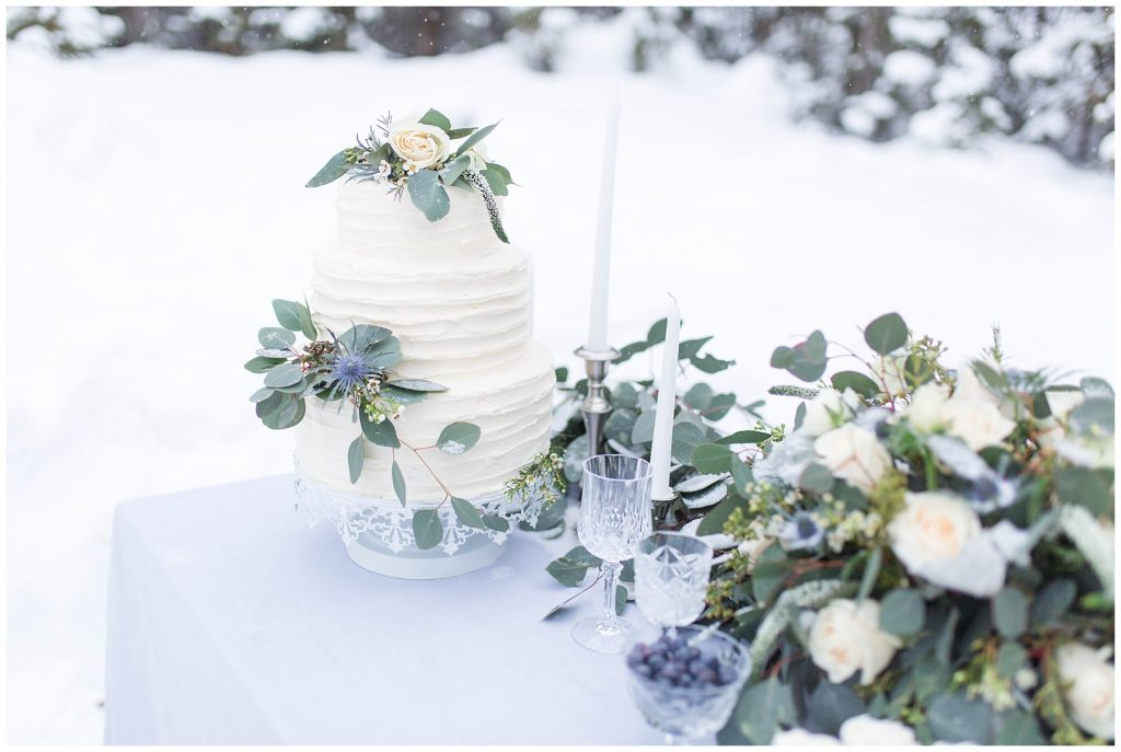 wedding cake and greenery flowers by changing dreams to reality with lots of flowers outdoors