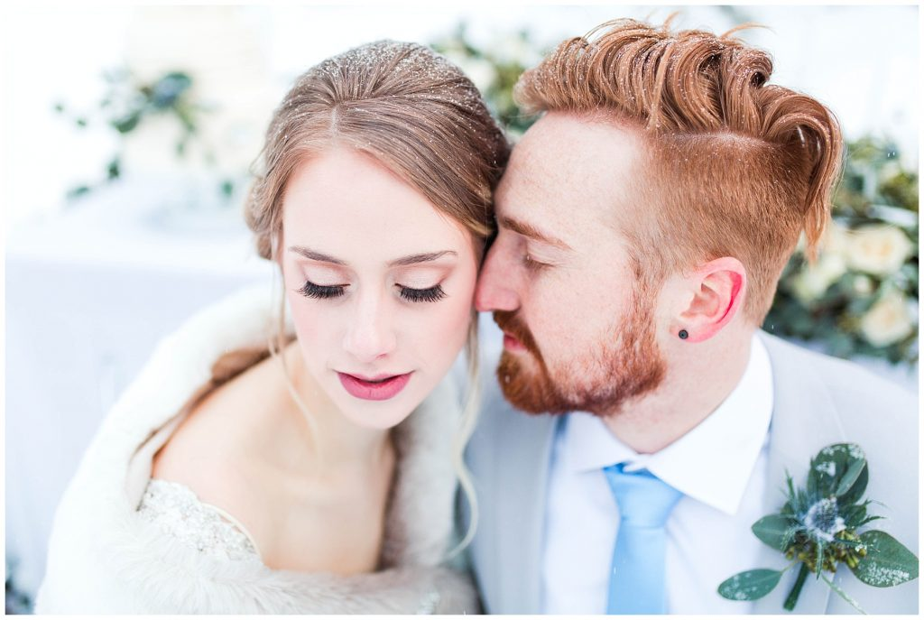 bride and groom close up with eyes closed for their winter wedding