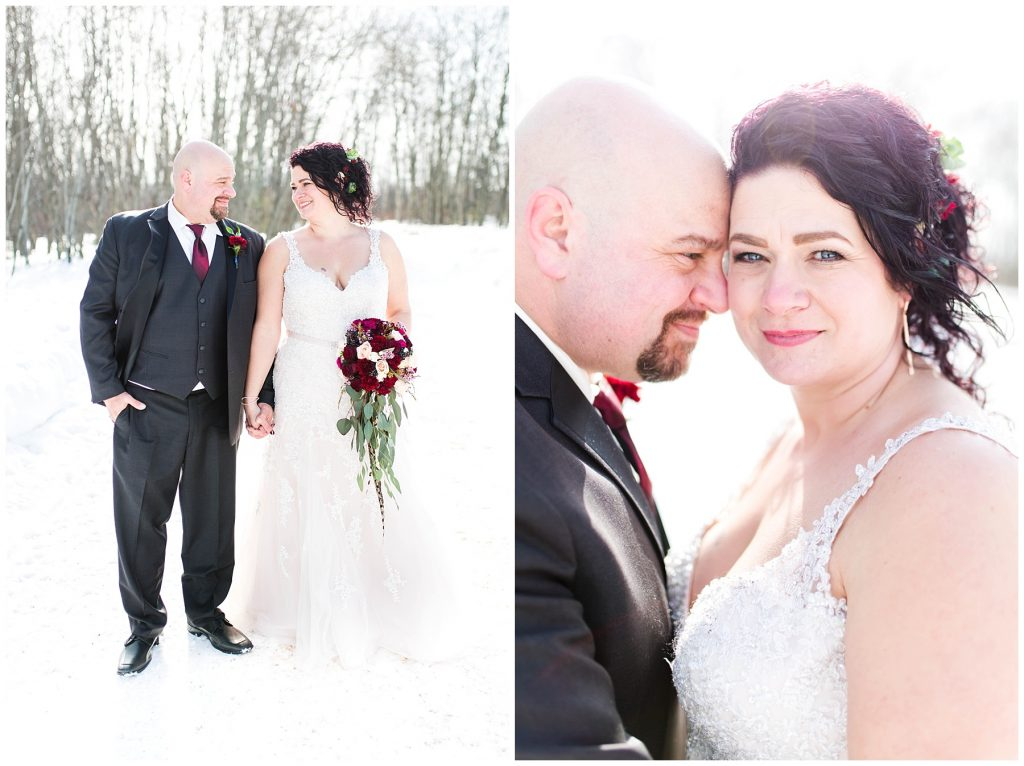 bride and groom outside with kayla lynn photography smiling and holsing hands outside in the winter with sun glowing behind them