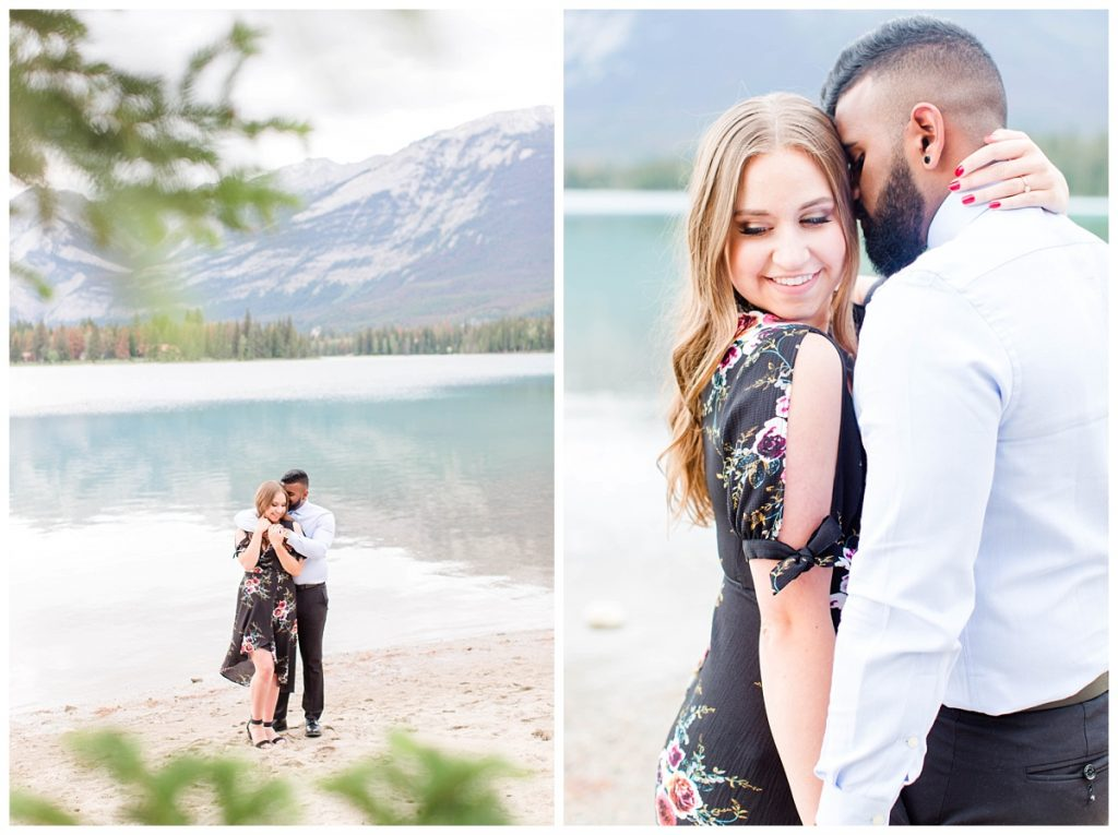 grande prairie wedding photographer with couple at lake annette in Jasper romantic couple wearing black dress and blue shirt