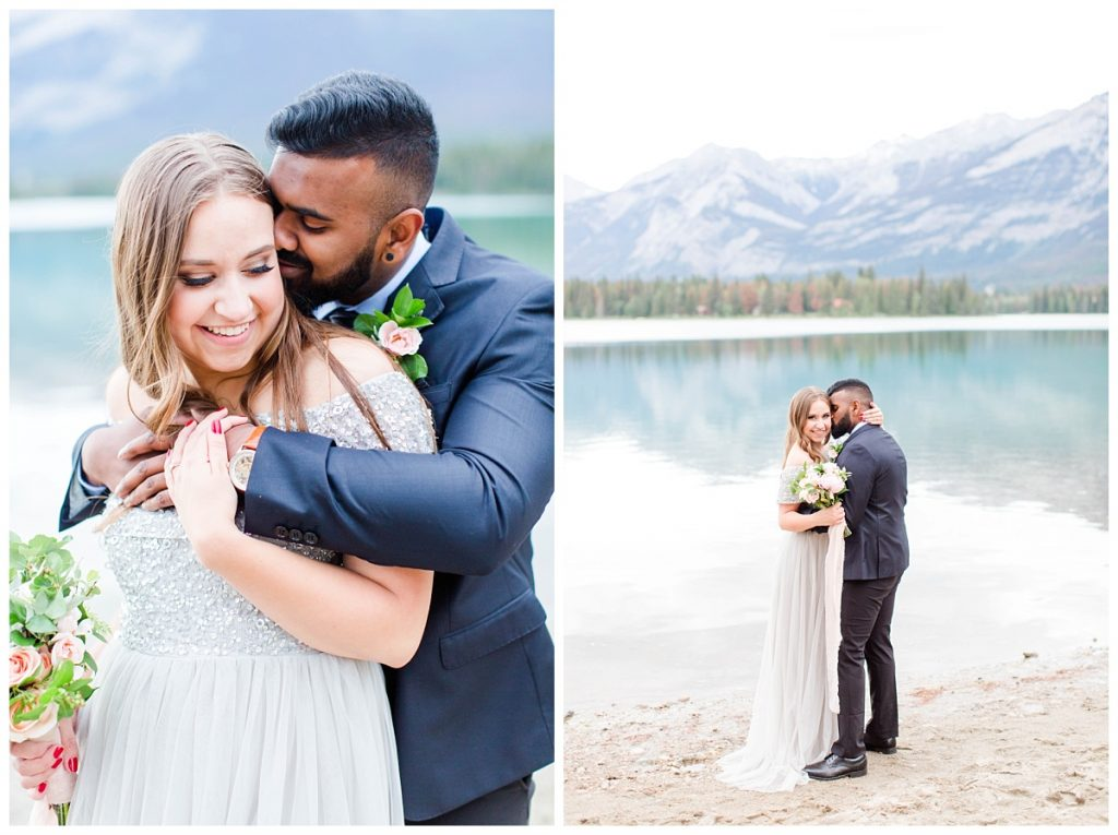 cute romantic couple at lake annette wearing light grey dress jasper and suit for engagement photos photographer from grande prairie elopement