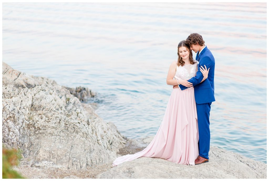 photography of engagement at lake minnewanka banff and jasper with light rock and clear blue water very romantic photos