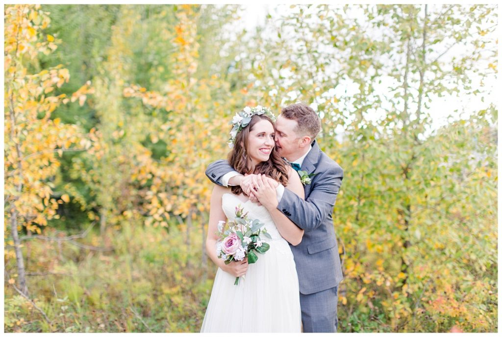 bride and groom in the fall wedding photos close up smiling nuzzle