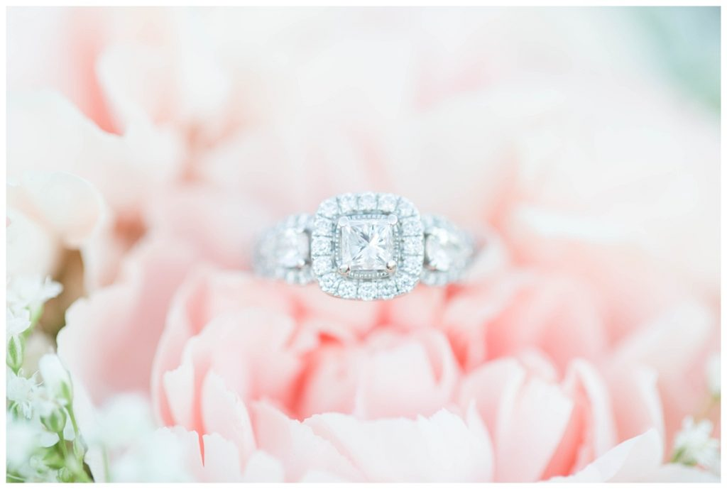 ring shot detail of engagement photos on blush pink flowers bouquet