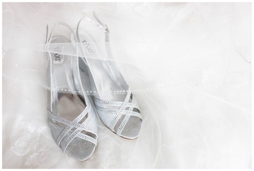 nicole bride wedding shoes detail photo very bright and airy they are sparkly and silver