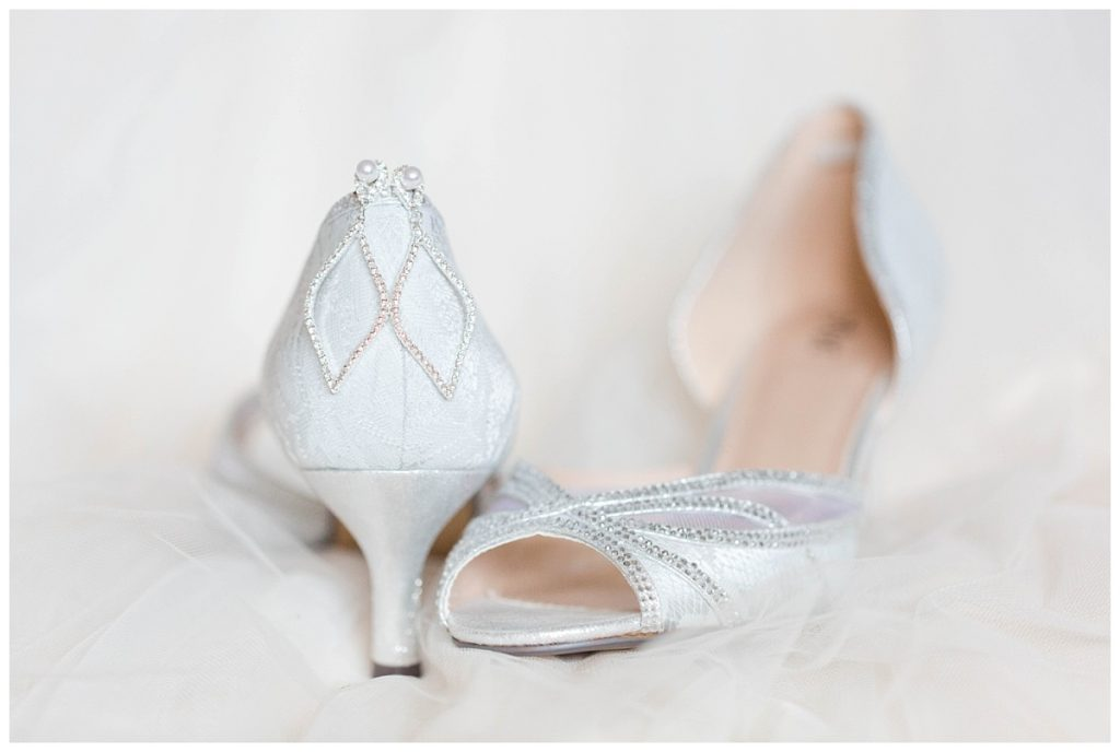 bride shoes detail photos very light and airy romantic in alberta with silver wedding rings too