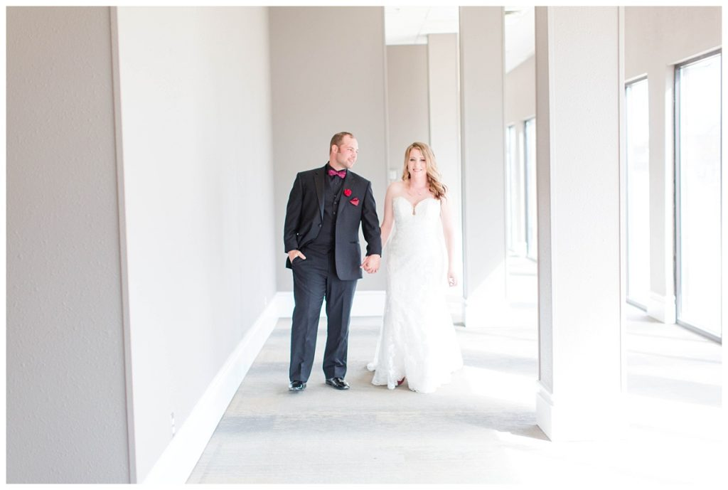 bride and groom walking inside the pomeroy hotel