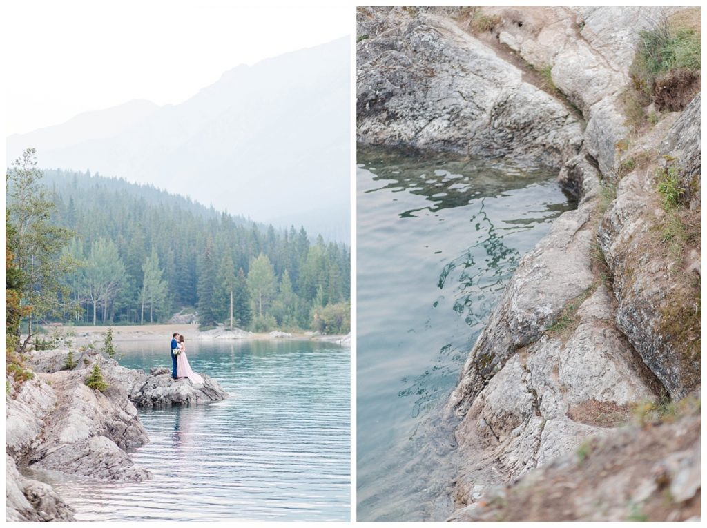 minnewanka lake engagement photos next to the mountains and water in banff and jasper clear blue with rocks and light pink blush dress