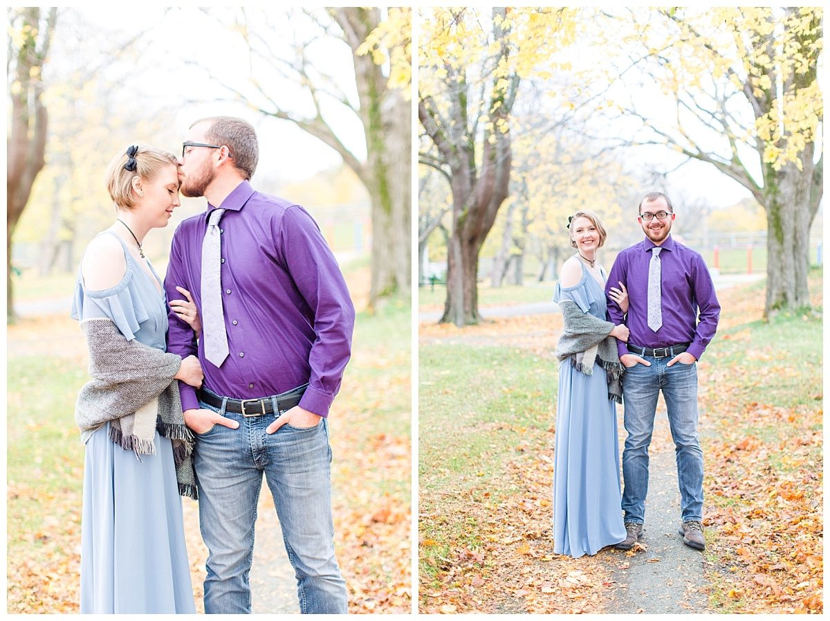 engagement photos in the fall park in st johns kissing on forhead and smiling at the camera