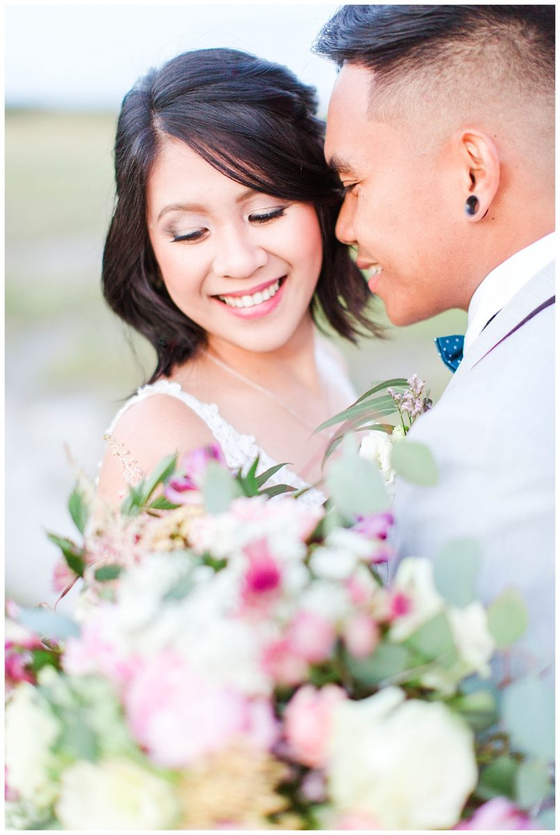 rex and jade close up with bridal bouquet during their style elopement