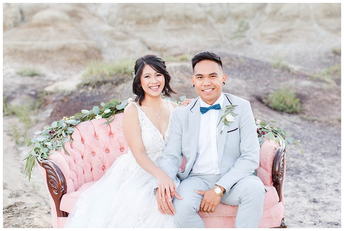 rex and jade smiling on the blush pink couch with vintage couch blush pink