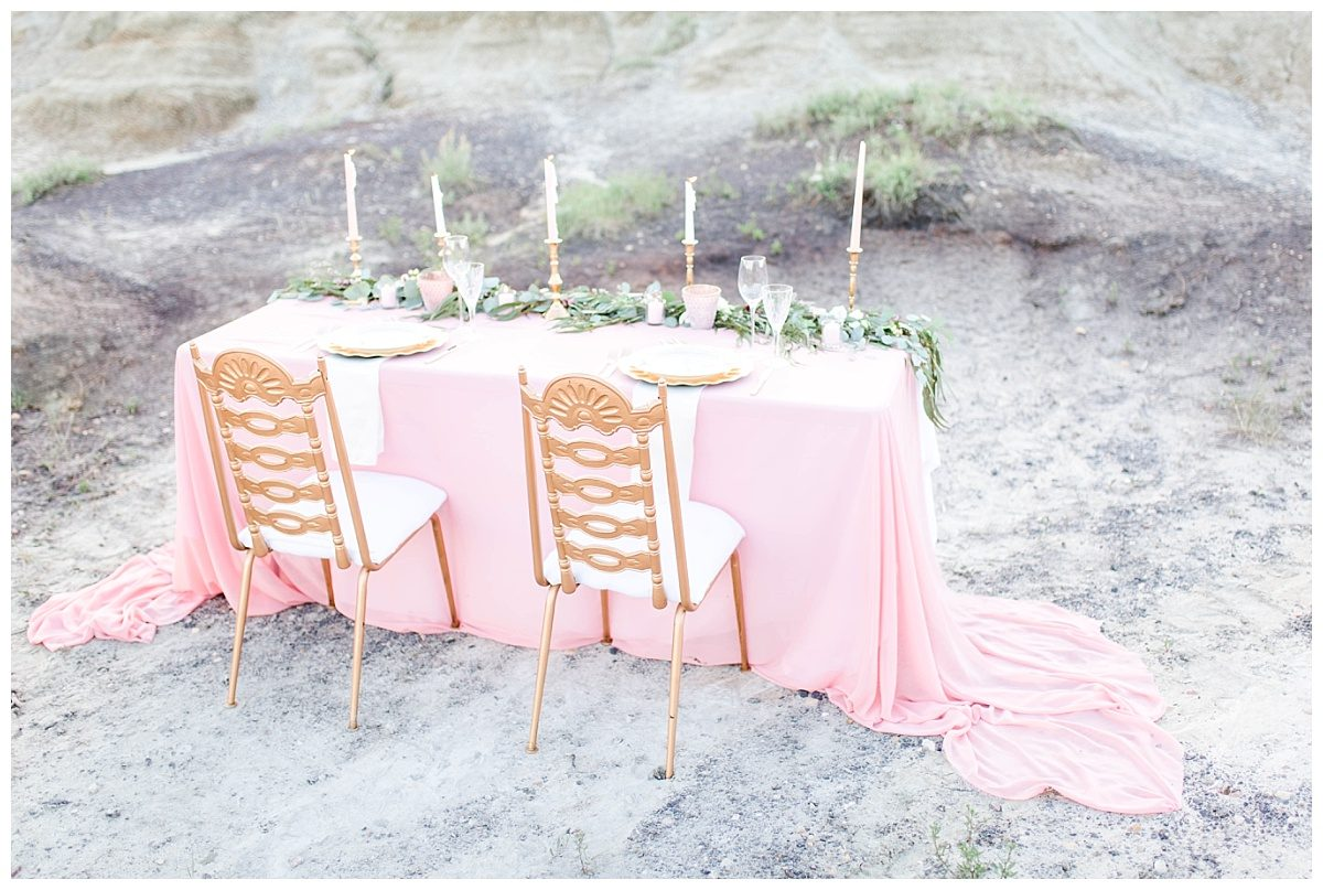 elegant blush pink sweetheart table for styled elopement wedding at kleskun hills with gold chiavari chairs drumheller and chiffon and greenery garland