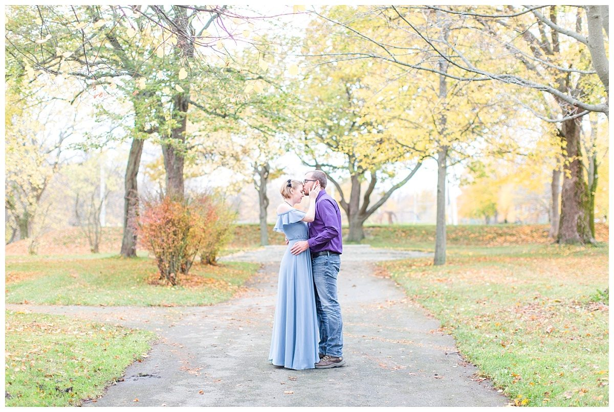 jd and megan romantic engagement photo fall in the park with yellow trees Newfoundland st johns