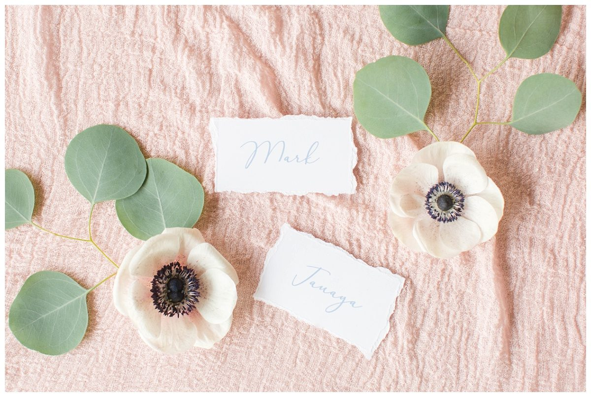 beautiful place cards 24th ave designs on light blush pink fabric and flowers from the enchanting bouquet with anemones silver dollar