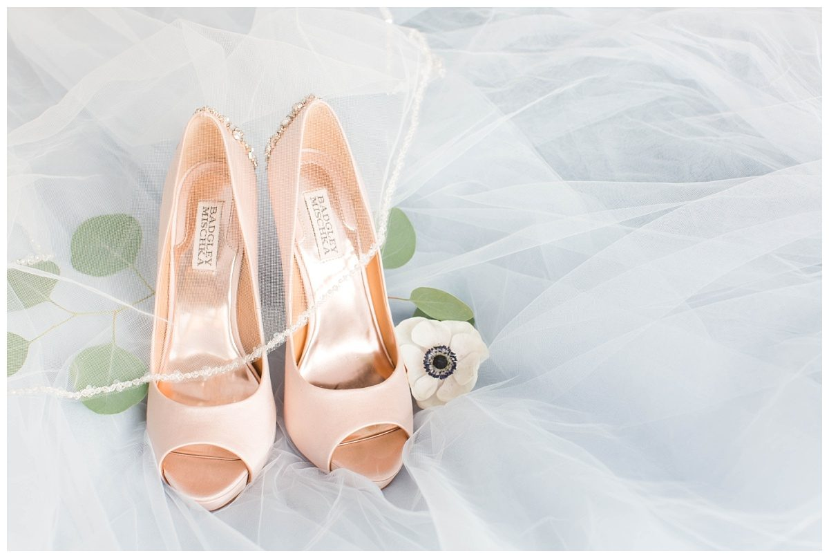 bridal detail photos with blush badgley mischka wedding shoes with flowers and tulle